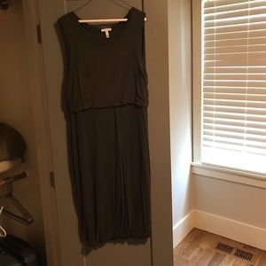 Green/olive sleeveless bodycon dress.  Size is L